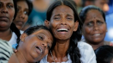 Relatives of the Burlington family weep during the funeral of their family members who were killed in the Easter Sunday bombings in Colombo, Sri Lanka, Tuesday, April 23, 2019. (AP Photo/Eranga Jayawardena)
