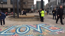 People gather at Mel Lastman Square Tuesday April 23, 2019 to mark one year since a deadly van attack on nearby Yonge Street that left 10 people dead and 16 injured. (Arda Zakarian /CP24)