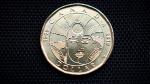 The new one-dollar coin honouring the progress made in the journey to equal rights for LGBTQ2 Canadians is photographed following the official unveiling event at a press conference in Toronto on Tuesday, April 23, 2019. THE CANADIAN PRESS/Tijana Martin