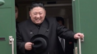 In this image from video released by Primorsky Regional Administration Press Service, North Korean leader Kim Jong Un smiles as he leaves Khasan train station in Primorye region, Russia, Wednesday, April 24, 2019.  (Primorsky Regional Administration Press Service via AP)