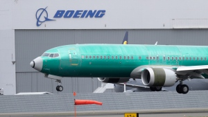 In this April 10, 2019, file photo a Boeing 737 MAX 8 airplane being built for India-based Jet Airways lands following a test flight at Boeing Field in Seattle. (AP Photo/Ted S. Warren, File)