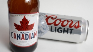 In this Feb. 14, 2018, file photo, Molson Coors products Molson Canadian beer, left, and Coors Light beer are shown in Walpole, Mass. A group of alcohol and cannabis companies have formed an industry alliance to push for changes to proposed rules governing pot-infused beverages before edibles become legal in the coming months. THE CANADIAN PRESS/AP Photo/Steven Senne, File