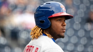 In this Sunday, April 14, 2019, photo, the Buffalo Bisons' Vladimir Guerrero Jr. waits on deck to bat during a Minor League Baseball game against the Scranton/Wilkes-Barre RailRiders in Moosic, Pa. Top Toronto Blue Jays prospect Guerrero Jr., will play his third game in three days for the first time this season on Wednesday as the Buffalo Bisons take on the Syracuse Mets. THE CANADIAN PRESS/ AP-Christopher Dolan/The Citizens' Voice via AP