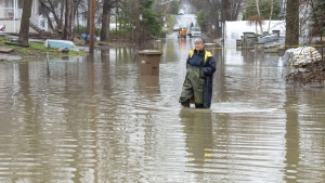 Michelle Belanger wades through floodwaters Wednesday, April 24, 2019 in Laval, Que.THE CANADIAN PRESS/Ryan Remiorz