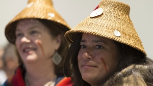 Former Justice Minister Jody Wilson-Raybould and former Treasury Board President Jane Philpott are seen as they take part in a first nations ceremony at the First Nations Justice Council in Richmond, B.C, Wednesday, Apr 24, 2019. THE CANADIAN PRESS/Jonathan Hayward