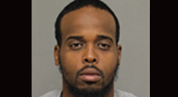 Muzamil Addow, a 28-year-old Toronto resident, is seen in this photo released by police.  A Canada-wide warrant has been issued for Addow's arrest. (York Regional Police handout)
