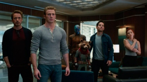 This image released by Disney shows, from left, Jeremy Renner, Don Cheadle, Robert Downey Jr., Chris Evans, Karen Gillan, the character Rocket, voiced by Bradley Cooper, Paul Rudd and Scarlett Johansson in a scene from 'Avengers: Endgame.' (Disney/Marvel Studios via AP)