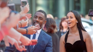 "Idris Elba and Sabrina Dhowre arrive on the red carpet for the premiere of the film ""The Mountain Between Us"" during the 2017 Toronto International Film Festival in Toronto on Sunday, September 10, 2017. THE CANADIAN PRESS/Frank Gunn"