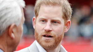 Britain's Prince Harry, right, speaks after the 39th London Marathon in London, Sunday, April 28, 2019. (AP Photo/Alastair Grant)