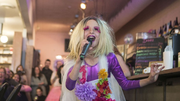 "Laddy Gaga performs at Toronto's Glad Books on Saturday, April 27, 2019. An over-the-top foursome who recently took over a bookstore/restaurant in Toronto's gay village are the stars of the Canadian documentary film, ""Drag Kids,"" making its debut at the Canadian International Documentary Film Festival.THE CANADIAN PRESS/Chris Young"