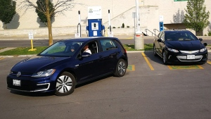 A Chevrolet Volt is plug into a charging station as a Volkswagen e-Golf backs into a parking spot at Lansdowne Mall in Peterborough, Ontario on Sunday June 17, 2018. Federal rebates to encourage Canadians to buy electric cars take effect today. THE CANADIAN PRESS/Doug Ives