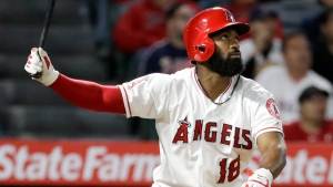 Los Angeles Angels' Brian Goodwin watches his home run against the Toronto Blue Jays during the eighth inning of a baseball game in Anaheim, Calif., Tuesday, April 30, 2019. (AP Photo/Chris Carlson)