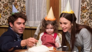"This image released by Netflix shows Zac Efron, left, and Lily Collins, right, in a scene from ""Extremely Wicked, Shockingly Evil, and Vile."" (Brian Douglas/Netflix via AP)"