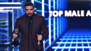 Drake accepts the the award for top male artist at the Billboard Music Awards on Wednesday, May 1, 2019, at the MGM Grand Garden Arena in Las Vegas. (Photo by Chris Pizzello/Invision/AP)