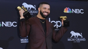 """Drake poses in the press room with his awards at the Billboard Music Awards on Wednesday, May 1, 2019, at the MGM Grand Garden Arena in Las Vegas. Drake won for top artist, top male artist, top billboard 200 artist, top hot 100 artist, top streaming songs artist, top song sales artist, top radio songs artist, top rap artist, top rap male artist, top billboard 200 album and top rap album for """"Scorpion,"""" and top streaming song video for """"In My Feelings.""""(Photo by Richard Shotwell/Invision/AP)"""
