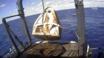 In this March 8, 2019 file image taken from video made available by NASA, the SpaceX Crew Dragon capsule is hoisted onto a ship in the Atlantic Ocean off the Florida coast after it returned from a mission to the International Space Station. SpaceX said Thursday, May 2, 2019, that their Dragon capsule for astronauts, which flew without a crew to the International Space Station last month, was destroyed during a ground test on April 20, 2019, in Cape Canaveral, Fla. (NASA via AP, File)