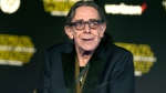 """In this Dec. 14, 2015, file photo, Peter Mayhew arrives at the world premiere of """"Star Wars: The Force Awakens"""" in Los Angeles. Mayhew, who played the rugged, beloved and furry Wookiee Chewbacca in the 'Star Wars' films, has died. Mayhew died at his home in north Texas on Tuesday, April 30, 2019 according to a family statement. He was 74. No cause was given. (Photo by Jordan Strauss/Invision/AP, File)"""