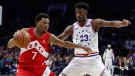 Toronto Raptors' Kyle Lowry, left, makes his move against Philadelphia 76ers' Jimmy Butler, right, during the second half of Game 4 of a second-round NBA basketball playoff series, Sunday, May 5, 2019, in Philadelphia. (AP Photo/Chris Szagola)