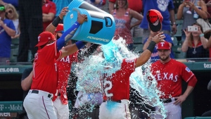 Texas Rangers second baseman Rougned Odor (12) gets the postgame dunk following the Rangers' 10-2 win against the Toronto Blue Jays in Arlington, Texas on Sunday, May 5, 2019. (AP Photo/ Louis DeLuca)