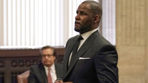 In this Friday, March 22, 2019 file photo, R. Kelly appears for a hearing at the Leighton Criminal Court Building in Chicago, Illinois. Dubai's government on Sunday forcefully denied a claim by R&B singer R. Kelly that the artist had planned concerts in the sheikhdom after he had sought permission from an Illinois judge to travel here despite facing sexual-abuse charges. (E. Jason Wambsgans/Chicago Tribune via AP, Pool, File)