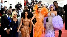 "Corey Gamble, from left, Kris Jenner, Kim Kardashian, Kendall Jenner, Kylie Jenner and Travis Scott attend The Metropolitan Museum of Art's Costume Institute benefit gala celebrating the opening of the ""Camp: Notes on Fashion"" exhibition on Monday, May 6, 2019, in New York. (Photo by Charles Sykes/Invision/AP)"