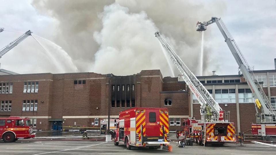 Crews battle a six-alarm fire at York Memorial Collegiate Institute Tuesday May 7, 2019. (Cristina Tenaglia /CP24)