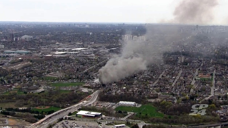 Smoke from a fire at York Memorial Collegiate Institute, near Eglinton Avenue and Trethewey Drive, is seen wafting over the city in this aerial image Tuesday May 7, 2019.