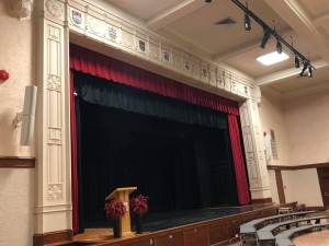 Plastered crests of the Canadian provinces hang above the auditorium stage at York Memorial Collegiate Institute. (Jim Djurakov /Facebook)