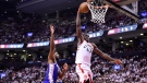 Toronto Raptors forward Pascal Siakam (43) dunks as Philadelphia 76ers centre Joel Embiid (21) defends during second half NBA playoff basketball action in Toronto on Tuesday, May 7, 2019. THE CANADIAN PRESS/Frank Gunn