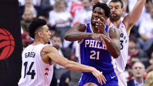 Philadelphia 76ers centre Joel Embiid (21) looses the ball as Toronto Raptors guard Danny Green (14) gains control during second half NBA playoff basketball action in Toronto on Tuesday, May 7, 2019. THE CANADIAN PRESS/Frank Gunn