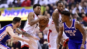 Toronto Raptors guard Kyle Lowry (7) controls the ball as Philadelphia 76ers guard JJ Redick (17) and Philadelphia 76ers guard Jimmy Butler (23) defend during second half NBA playoff basketball action in Toronto on Tuesday, May 7, 2019. THE CANADIAN PRESS/Frank Gunn