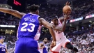 Toronto Raptors forward Pascal Siakam (43) is fouled by Philadelphia 76ers guard Jimmy Butler (23) during second half NBA playoff basketball action in Toronto on Tuesday, May 7, 2019. THE CANADIAN PRESS/Frank Gunn