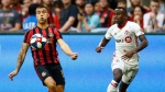 Atlanta United forward Hector Villalba looks to settle the ball next to Toronto FC midfielder Richie Laryea during the first half of an MLS soccer match in Atlanta on Wednesday, May 8, 2019. (AP Photo/Mike Zarrilli)