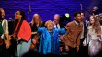 """Singer Mavis Staples, center, performs at the Apollo Theater to celebrate the release of her new album """"We Get By,"""" on Thursday, May 9, 2019, in New York. (Photo by Brad Barket/Invision/AP)"""
