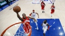 Toronto Raptors' Kawhi Leonard, left, goes up for a shot past Philadelphia 76ers' Tobias Harris (33) and James Ennis III during the first half of Game 6 of a second-round NBA basketball playoff series Thursday, May 9, 2019, in Philadelphia. (AP Photo/Chris Szagola)