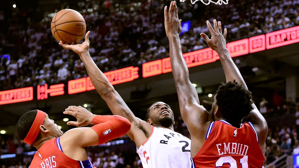 Philadelphia 76ers forward Tobias Harris (33) fouls Toronto Raptors forward Kawhi Leonard (2) as he goes to the net under pressure from Philadelphia 76ers centre Joel Embiid (21) during second half NBA Eastern Conference semifinal action in Toronto on Sunday, May 12, 2019. THE CANADIAN PRESS/Frank Gunn