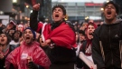 Adam Siddiq jumps in the air as fans react to game action as the Toronto Raptors play the Philadelphia 76ers during first half NBA Eastern Conference semifinal action in Toronto on Sunday, May 12, 2019. THE CANADIAN PRESS/Tijana Martin