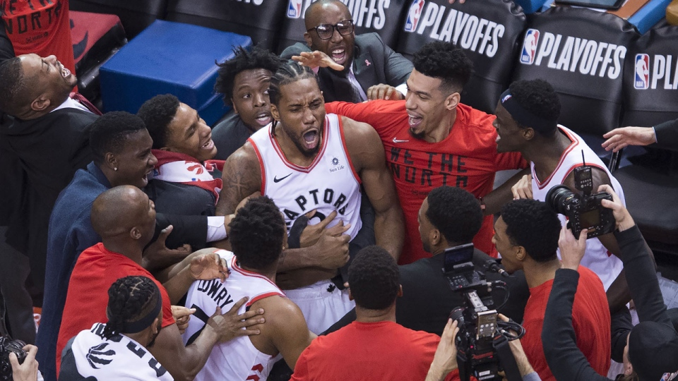 Toronto Raptors forward Kawhi Leonard (2) reacts with teammates after making the buzzer beating shot to defeat the Philadelphia 76ers at the end of second half Eastern Conference semifinal NBA playoff basketball action in Toronto on Sunday, May 12, 2019. THE CANADIAN PRESS/Nathan Denette