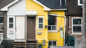"The exterior of ""lil' yellow house"" in the Upper Beaches is seen. (Real Estate by Bike)"