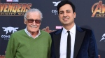"""In this April 23, 2018, file photo, Stan Lee, left, and Keya Morgan arrive at the world premiere of """"Avengers: Infinity War"""" in Los Angeles. Attorney Alex Kessel entered a not-guilty plea in Los Angeles Superior Court on Monday, July 2, 2018, for Morgan, who is charged with calling 911 to report that detectives and a social worker conducting a welfare check on the 95-year-old Lee were burglars. (Photo by Jordan Strauss/Invision/AP, File)"""