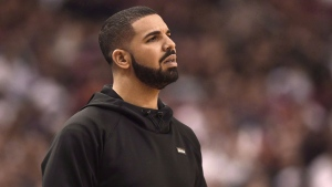 Drake watches the action between the Indiana Pacers and the Toronto Raptors during first half NBA playoff basketball action in Toronto on Tuesday, April 26, 2016. THE CANADIAN PRESS/Frank Gunn