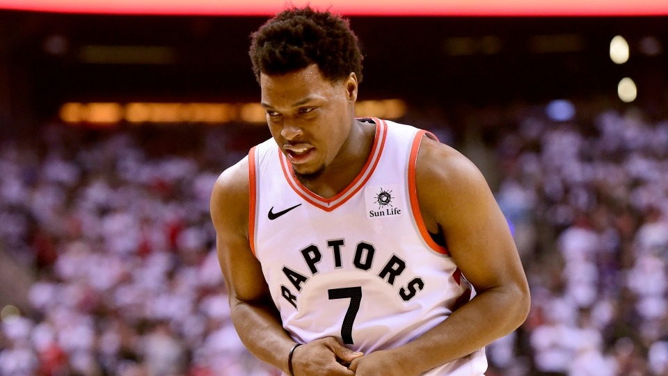 Toronto Raptors guard Kyle Lowry (7) walks off the court nursing his left hand during first half NBA Eastern Conference semifinal action against the Philadelphia 76ers, in Toronto on Sunday, May 12, 2019. Kyle Lowry joked about the padded compression glove he wore on his injured left hand Wednesday morning. THE CANADIAN PRESS/Frank Gunn