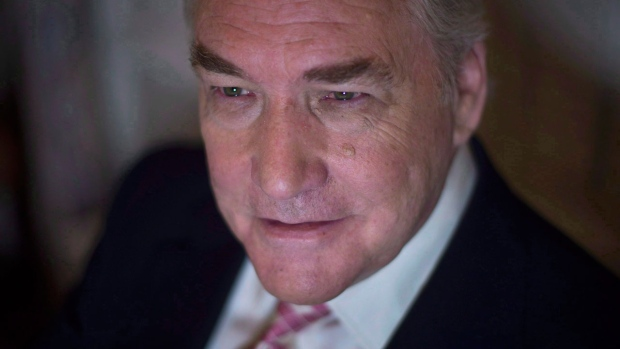 Trump pardons Conrad Black, author of flattering Trump biography