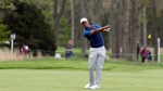 Tiger Woods hits a shot off the 10th fairway during the first round of the PGA Championship golf tournament, Thursday, May 16, 2019, at Bethpage Black in Farmingdale, N.Y. (AP Photo/Julio Cortez)
