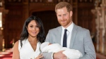 Britain's Prince Harry and Meghan, Duchess of Sussex, during a photocall with their newborn son, in St George's Hall at Windsor Castle, Windsor, south England on May 8, 2019. THE CANADIAN PRESS/AP, Dominic Lipinski - POOL