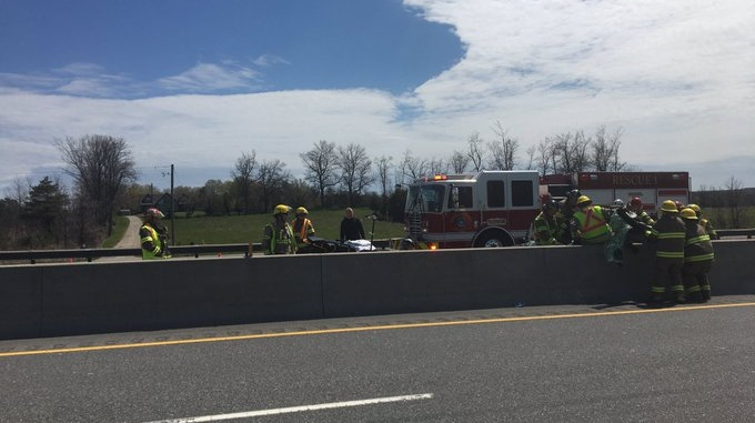Firefighters are shown at the scene of a serious collision on Hwy. 400. (Twitter/@FinnSpirit)