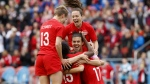 Team Canada captain Christine Sinclair (12) celebrates a goal by midfielder Jessie Fleming (17) with teammates Allysha Chapman (2) and Sophie Schmidt (13) during the first half of a women's international soccer friendly against Mexico at BMO field in Toronto, Saturday, May 18, 2019. THE CANADIAN PRESS/Cole Burston