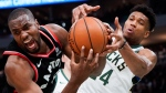 Milwaukee Bucks' Giannis Antetokounmpo tries to steal the ball from Toronto Raptors' Serge Ibaka during the second half of Game 2 of the NBA Eastern Conference basketball playoff finals Friday, May 17, 2019, in Milwaukee. The Bucks won 125-103 to take a 2-0 lead in the series. (AP Photo/Morry Gash)