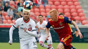 Toronto FC midfielder Alejandro Pozuelo (10) and Real Salt Lake midfielder Kyle Beckerman (5) battle for the ball during the first half of an MLS soccer match Saturday, May 18, 2019, in Sandy, Utah. (AP Photo/Rick Bowmer)