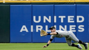 Toronto Blue Jays center fielder Randal Grichuk makes a diving catch on a fly ball by Chicago White Sox's Leury Garcia during the second inning of a baseball game in Chicago, Saturday, May 18, 2019. (AP Photo/Nam Y. Huh)